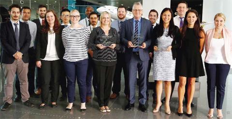 Shane O'Hare, Etihad Airways' Senior Vice President Marketing (first row - fourth from right); Elizabeth Selby, Etihad Airways' Head of Social Media (first row - third from right); and the airline's social media team, celebrate its success at the SimpliFlying Awards.
