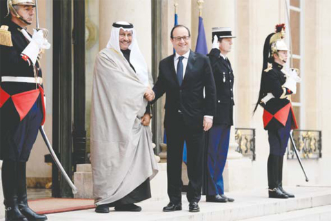 French President Francois Hollande meets Kuwaiti Prime Minister HH Sheikh Jaber Al-Mubarak Al- Sabah yesterday at the Elysee Palace. — AFP