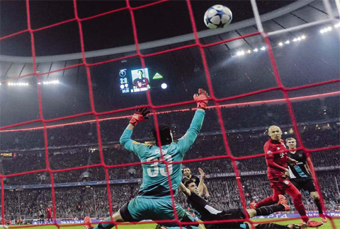 Bayern Munich's Dutch midfielder Arjen Robben scores the fourth goal past Arsenal's Czech goalkeeper Petr Cech during the UEFA Champions League Group F second-leg football match between FC Bayern Munich and Arsenal FC in Munich, southern Germany on November 4, 2015. — AFP