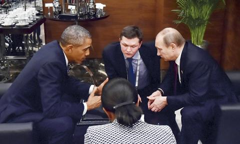 ANTALYA, Turkey: US President Barack Obama (left) speaks with Russian President Vladimir Putin (right) prior to the opening session of the G20 summit yesterday. — AP