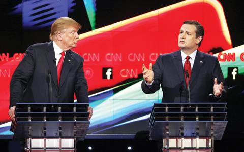 LAS VEGAS: Donald Trump watches as Ted Cruz speaks during the CNN Republican presidential debate at the Venetian Hotel & Casino. — AP