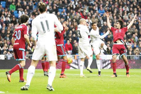 MADRID: Real Madrid's Portuguese forward Cristiano Ronaldo (2ndR) kicks to score during the Spanish league football match Real Madrid CF vs Real Sociedad de Futbol at the Santiago Bernabeu stadium in Madrid yesterday. - AFP