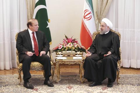 TEHRAN: Iranian President Hassan Rouhani meets Pakistani Prime Minister Nawaz Sharif yesterday. — AP