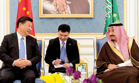 RIYADH: Saudi King Salman bin Abdelaziz meets Chinese President Xi Jinping upon the latter's arrival in the Saudi capital. — AFP