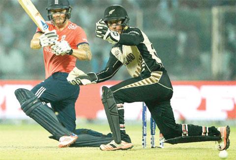NEW DELHI: England's Jason Roy (L) plays a shot past New Zealand's wicketkeeper Luke Ronchi during the World T20 cricket tournament semi-final match between England and New Zealand at The Feroz Shah Kotla Cricket Ground. — AFP
