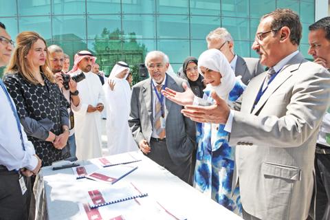 Chairman of Institute Regents Dr Hilal Al-Sayer, Zain Kuwait's CEO Iman Al- Roudhan and Director General of the Dasman Diabetes Institute Dr Qais Al-Duwairi tour an exhibition held as part of the event
