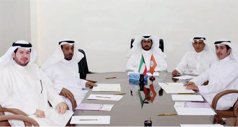 KUWAIT: The Kuwait Trade Union Federation Chairman Salem Al-Ajmi (center) attends the signing ceremony