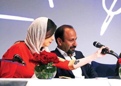 Iranian actress Taraneh Alidoosti (left), Iranian director Asghar Farhadi
