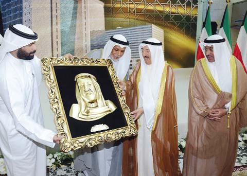 KUWAIT: His Highness the Amir Sheikh Sabah Al-Ahmad Al- Jaber Al-Sabah is presented with a gift to mark the occasion. — Amiri Diwan photos