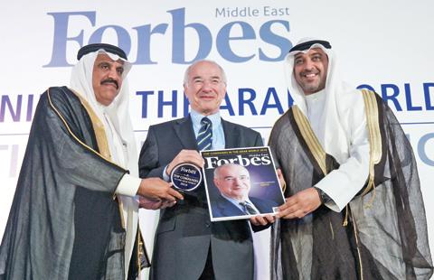 Samer Khanachet (center) receiving the award from Sheikh Mohammad Abdullah Al-Mubarak (right) and Dr Nasser Al Tayyar.