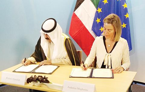 BRUSSELS: Kuwait's Deputy Minister for Foreign Affairs Ambassador Suleiman Al-Jarallah (left) and EU High Representative Federica Mogherini sign the agreement.—KUNA