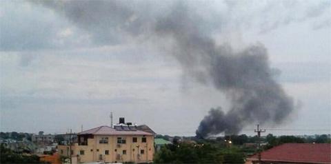 JUBA, SOUTH SUDAN: Black smoke is seen rising above the capital on Sunday. — AP