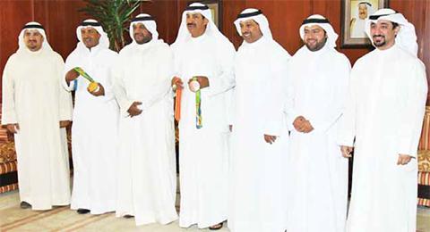 KUWAIT: Director General of Public Authority for Sports Sheikh Ahmad Mansour Al-Sabah receives winning shooters Feheid Al-Deehani and Abdullah Al-Tarqi. — KUNA