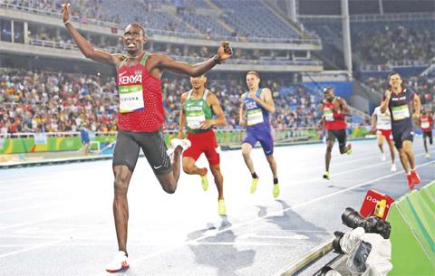 RIO DE JANEIRO: Kenya's David Lekuta Rudisha (left) celebrates after winning the Men's 800m Final during the athletics competition at the Rio 2016 Olympic Games at the Olympic Stadium in Rio de Janeiro on August 15, 2016. — AFP