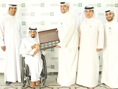 Al-Mutairi receiving the award