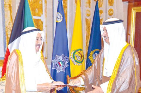 KUWAIT: HH the Amir Sheikh Sabah Al-Ahmad Al-Jaber Al-Sabah (left) receives a decree to dissolve the National Assembly from HH the Prime Minister Sheikh Jaber Al-Mubarak Al-Hamad Al-Sabah yesterday. — Amiri Diwan