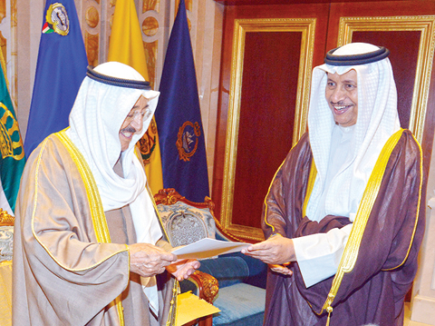 KUWAIT: HH the Prime Minister Sheikh Jaber Al-Mubarak Al-Hamad Al-Sabah (right) submits the Cabinet's resignation to HH the Amir Sheikh Sabah Al-Ahmad Al-Jaber Al-Sabah at Bayan Palace yesterday. —- KUNA