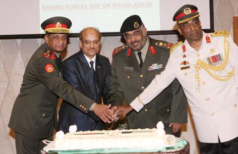 KUWAIT: Brigadier Ghazi Al-Shammari, Brigadier Mohammad Nasim Al-Ghani and other officials cut the ceremony's cake. — Photos by Joseph Shagra