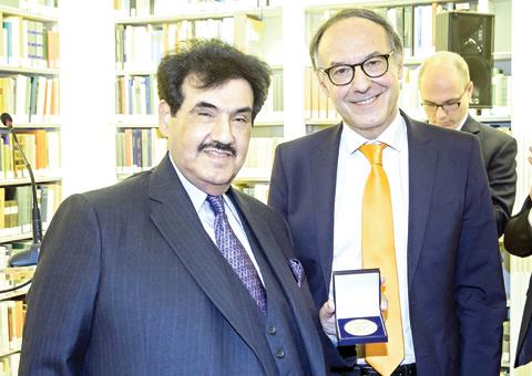 GENEVA: His Highness Sheikh Nasser Al-Mohammad Al-Ahmad Al-Jaber Al-Sabah poses with a medal presented by President of Geneva University Professor Yves Flueckiger. — KUNA