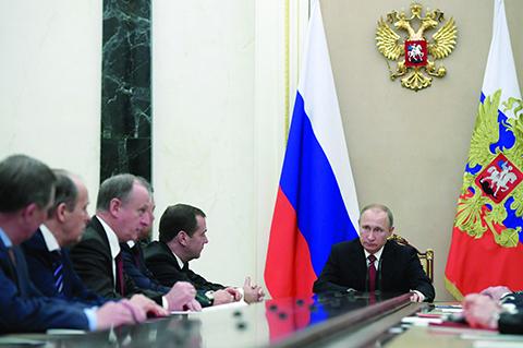 Russian President Vladimir Putin, right, chairs a Security Council meeting in the Kremlin in Moscow, Russia, Thursday, Dec. 1, 2016. (Alexei Druzhinin, Sputnik, Kremlin Pool Photo via AP)