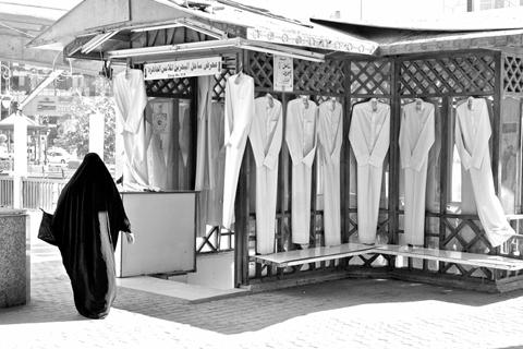 Readymade dishdashas shopfront. — Photo by Dr.Moayad H. Hussain