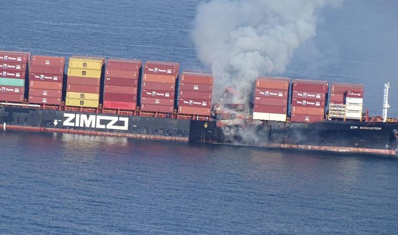 Burning cargo ship spews toxic gas off Canada